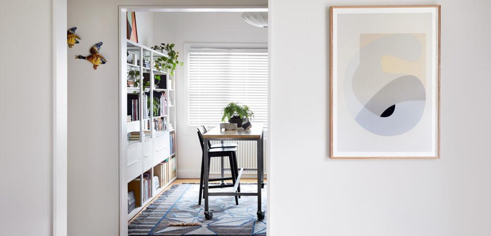 Maike Design bookshelves and workbench with artwork