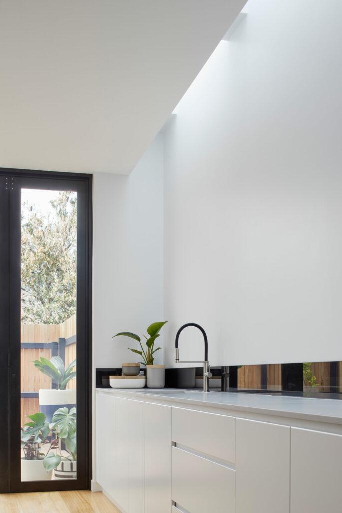 Maike Design white kitchen and skylight