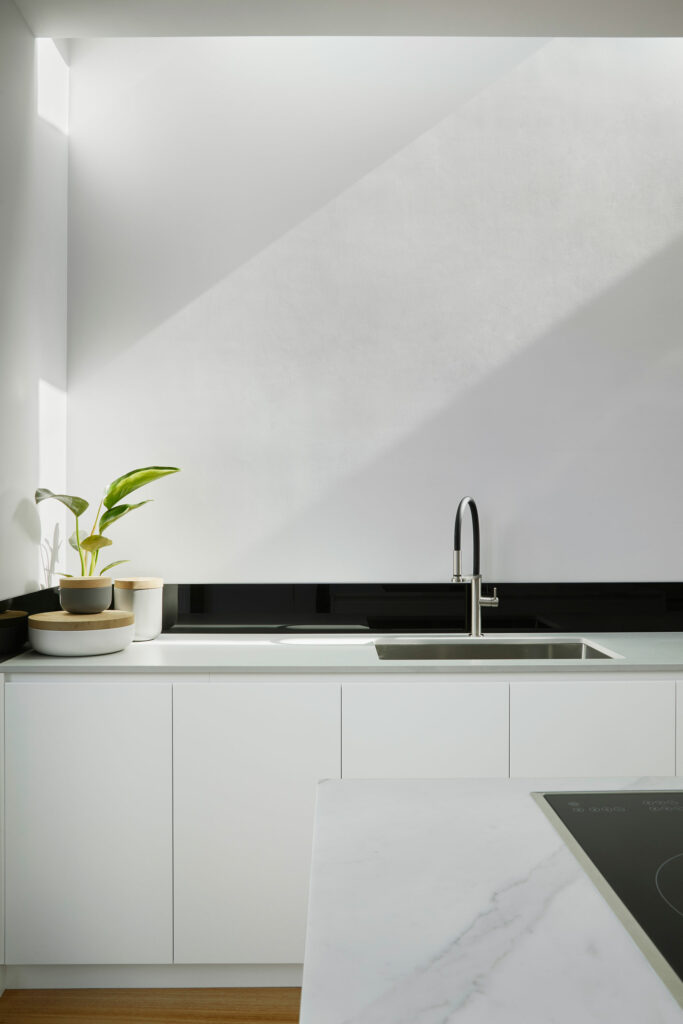 Maike Design white kitchen, inset sink and skylight