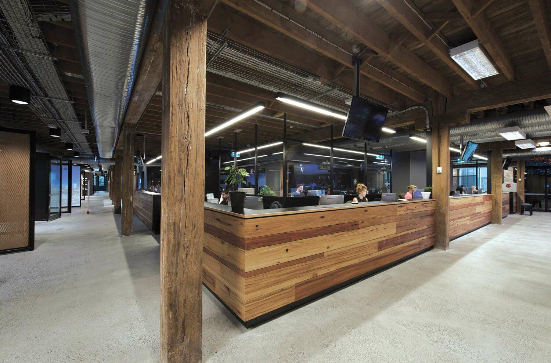 Maike Design Creative design school, warehouse conversion. Timber reception desk and original timber framing