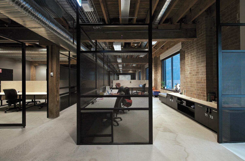 Maike Design Creative design school, warehouse conversion. Black framing and screens