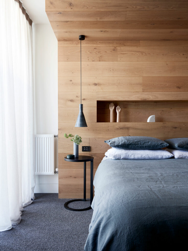 Maike Design bedroom, timber bedhead wall with storage