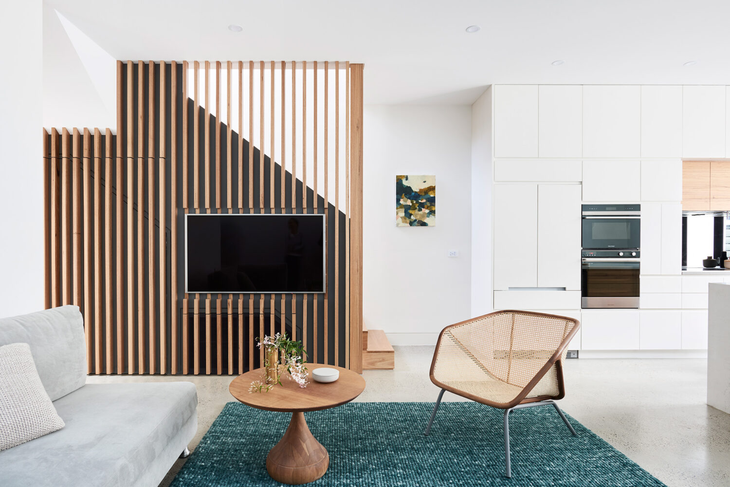Maike Design lounge room with timber batten wall balustrade