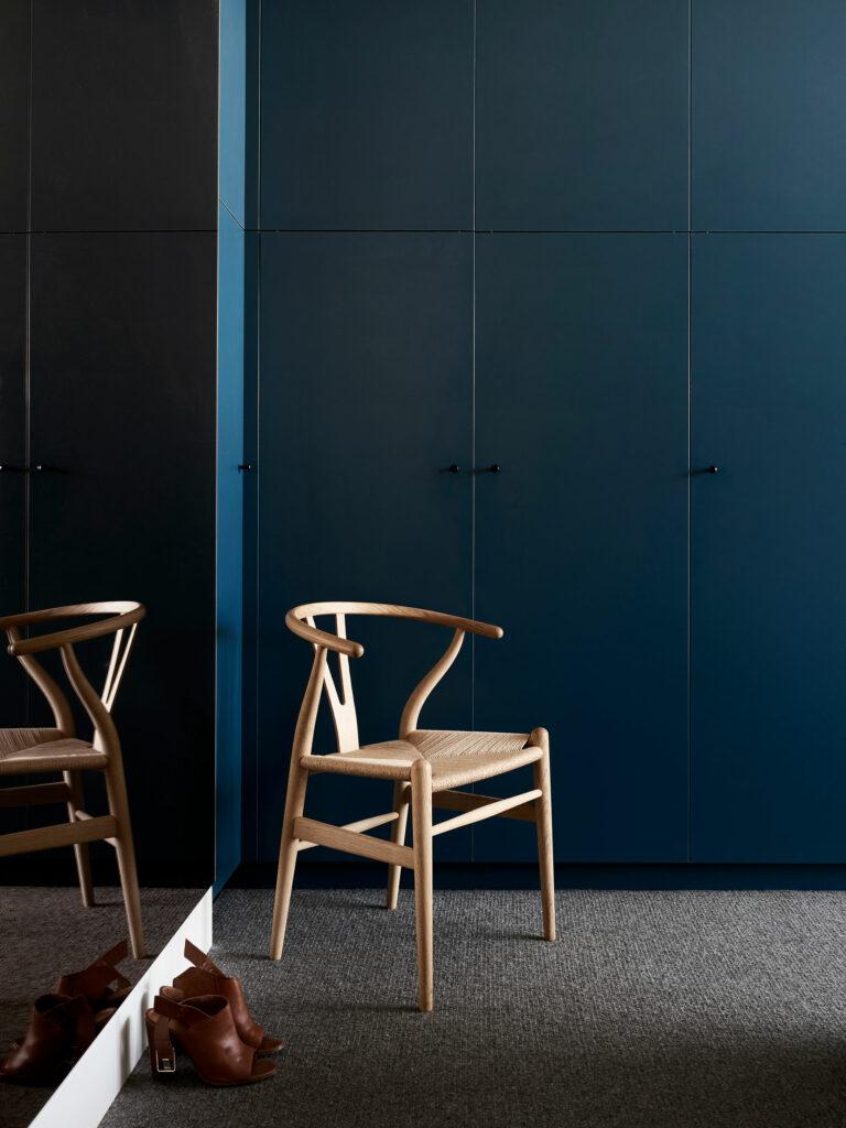 Maike Design moody dark teal bedroom cabinets and bronze mirror