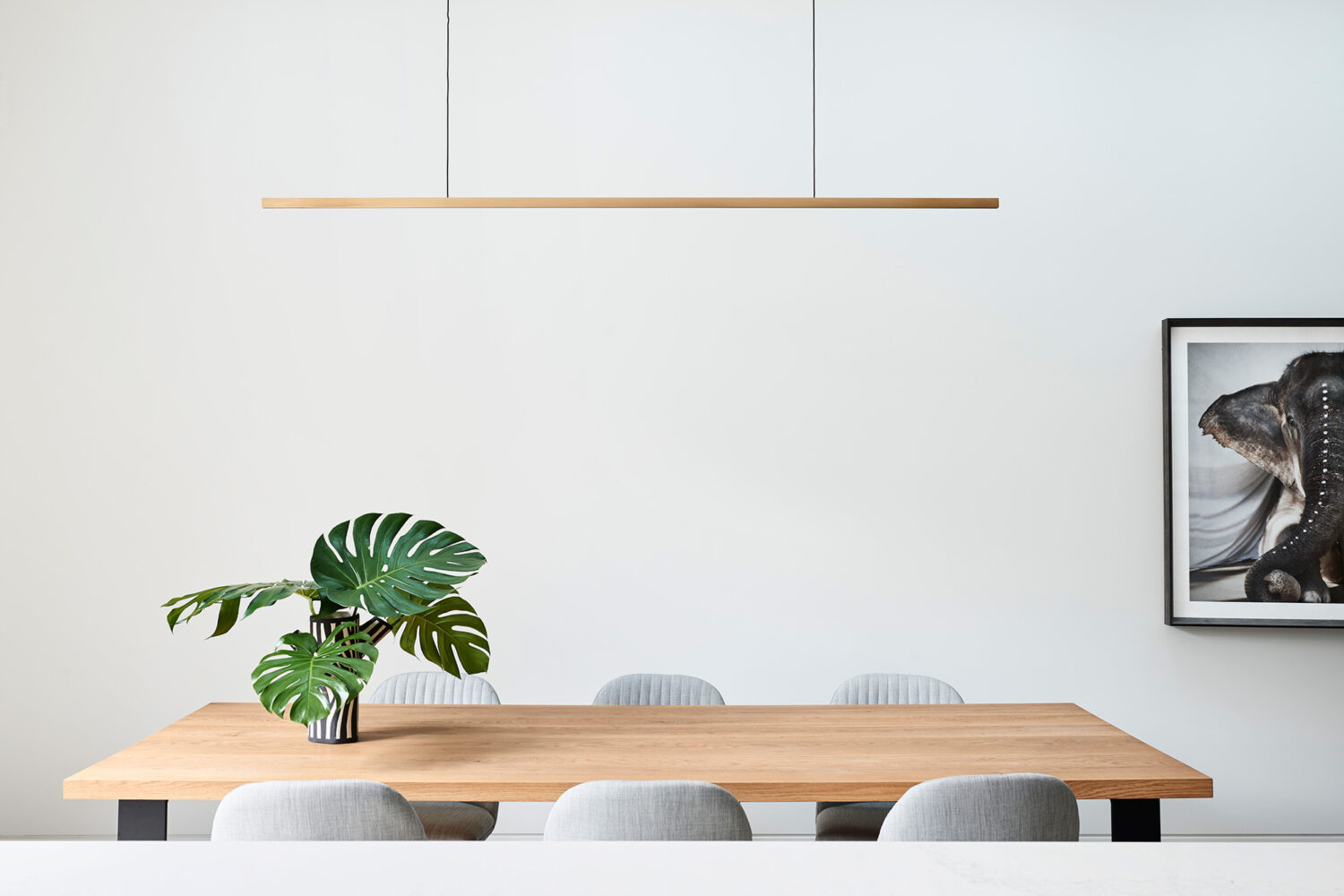 Maike Design timber dining table with pendant light
