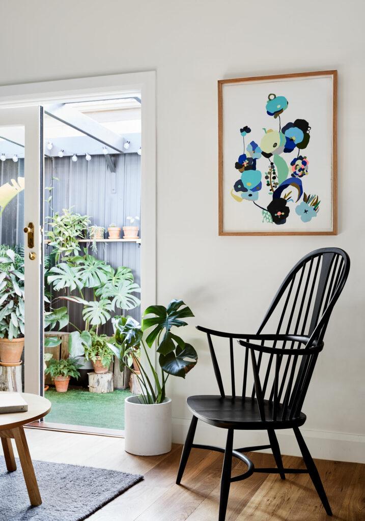 Maike Design lounge opening onto courtyard garden