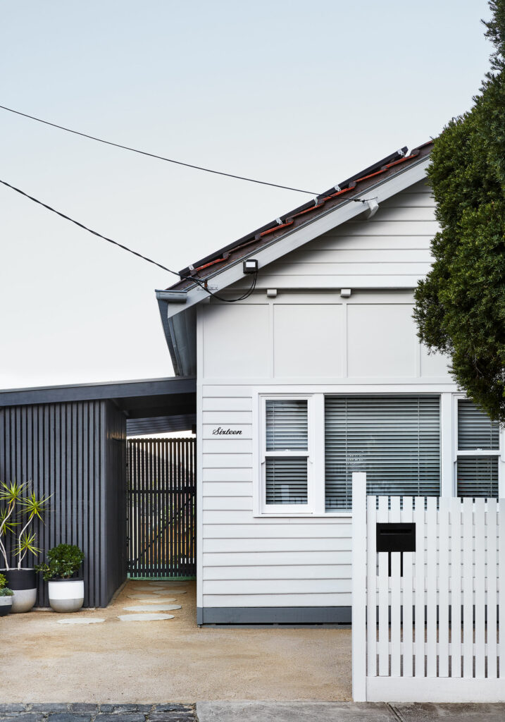 Maike Design exterior weatherboard facade and stepping stones to entry