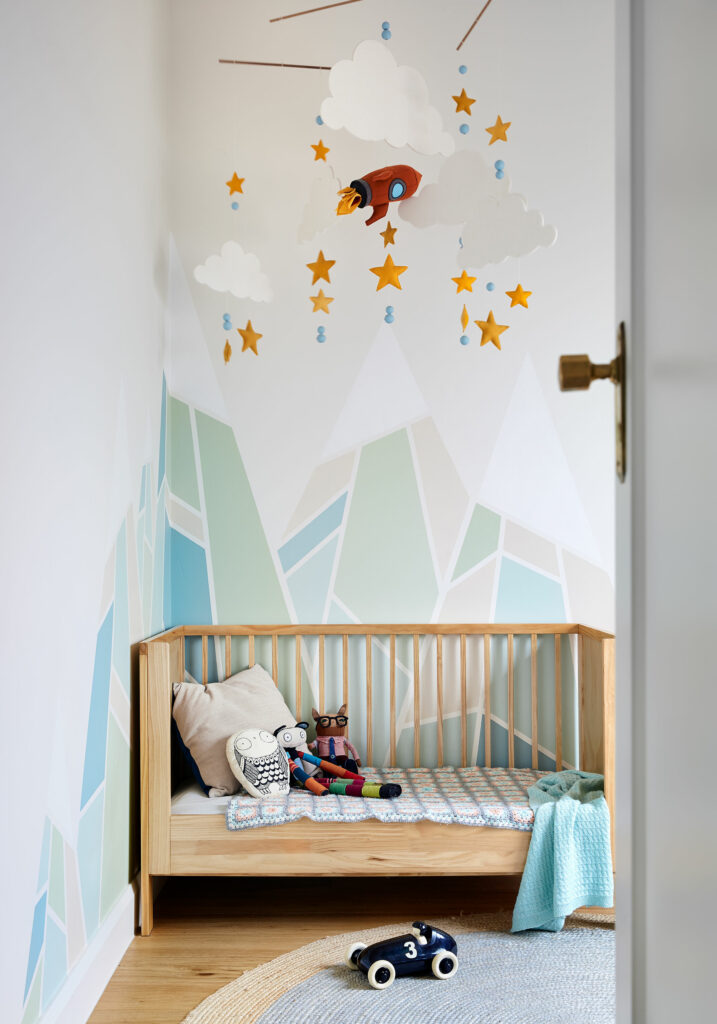 Maike Design nursery with hand made mobile and hand painted mural