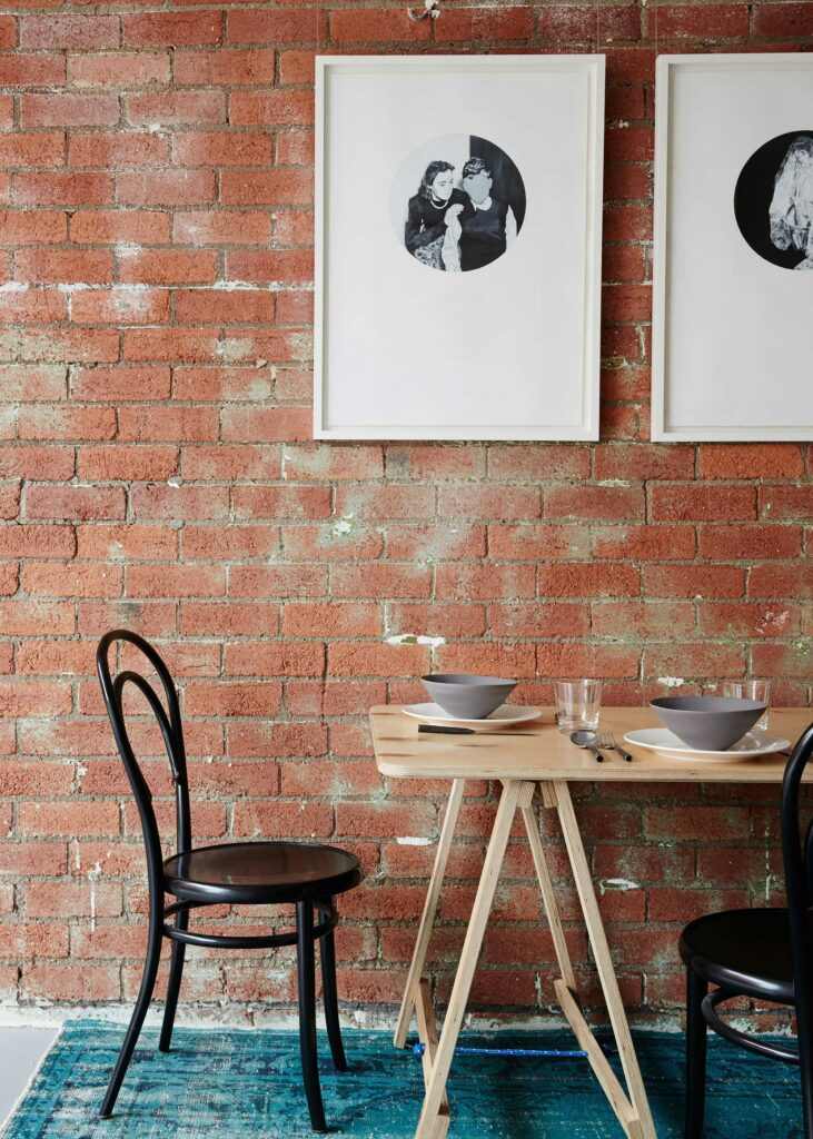 Maike Design Creative workspace, warehouse conversion. Red brick wall and dining table