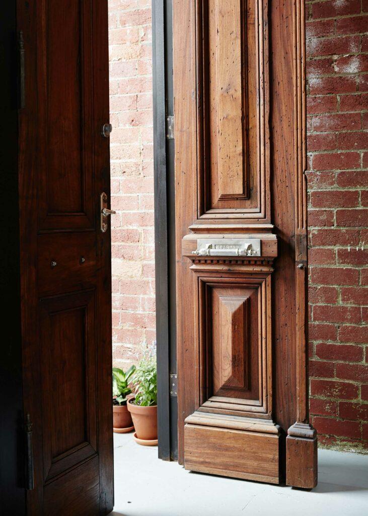 Maike Design Creative workspace, warehouse conversion. Antique entry doors