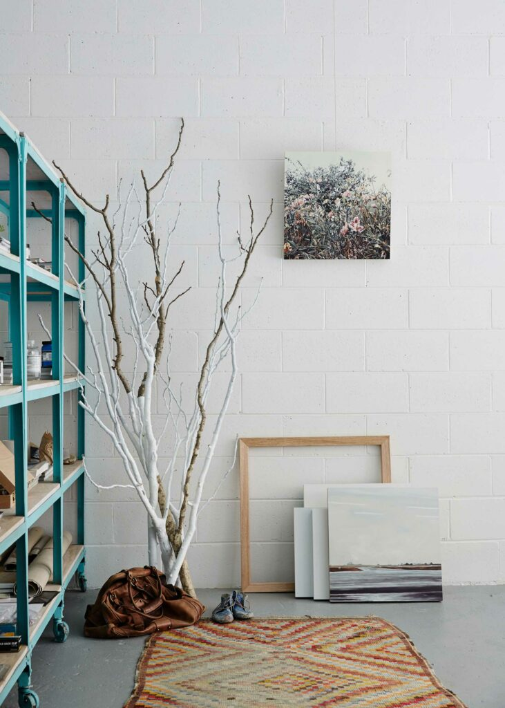 Maike Design Creative workspace, warehouse conversion. Painting studio, coloured rug and frames