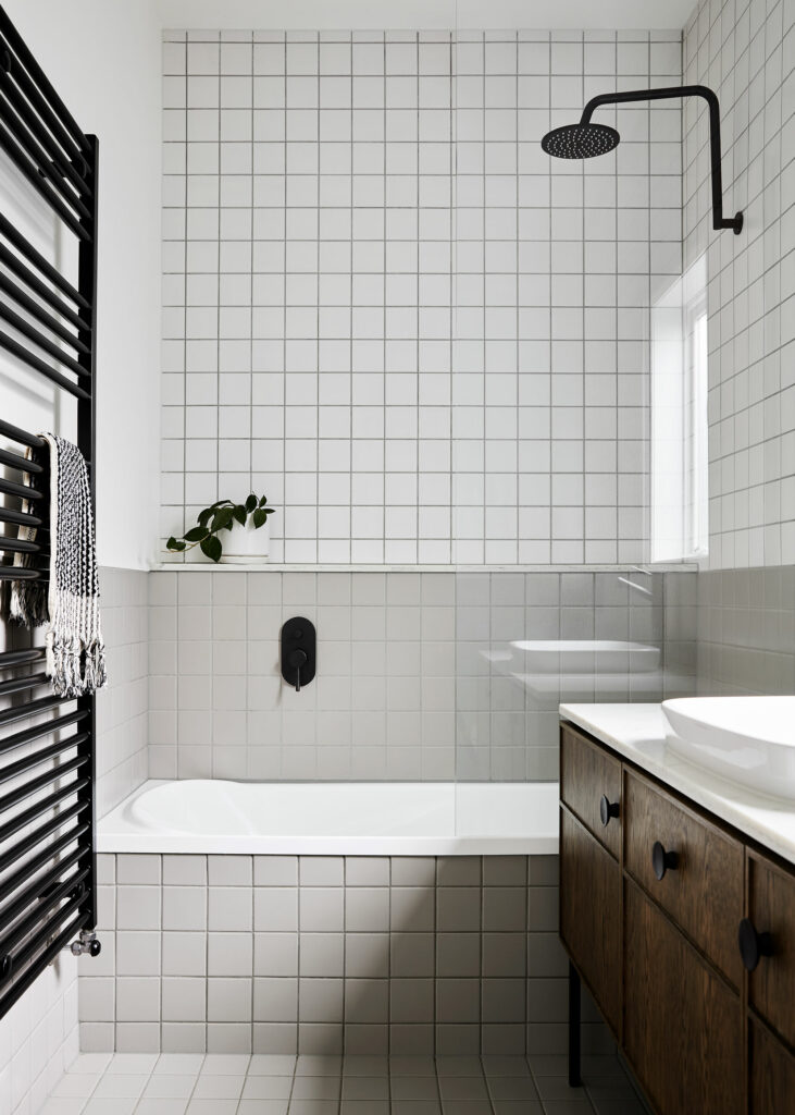 Maike Design two tone bathroom. Timber vanity and black tapware