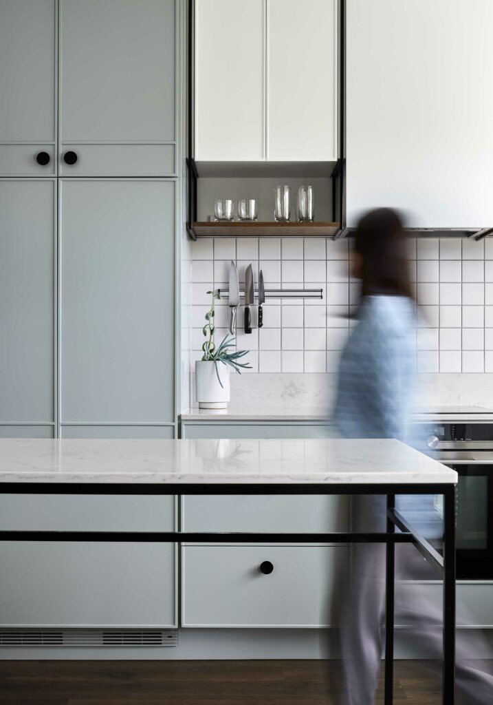 Maike Design light green kitchen. Custom cupboard design, black handles and marble benchtop.