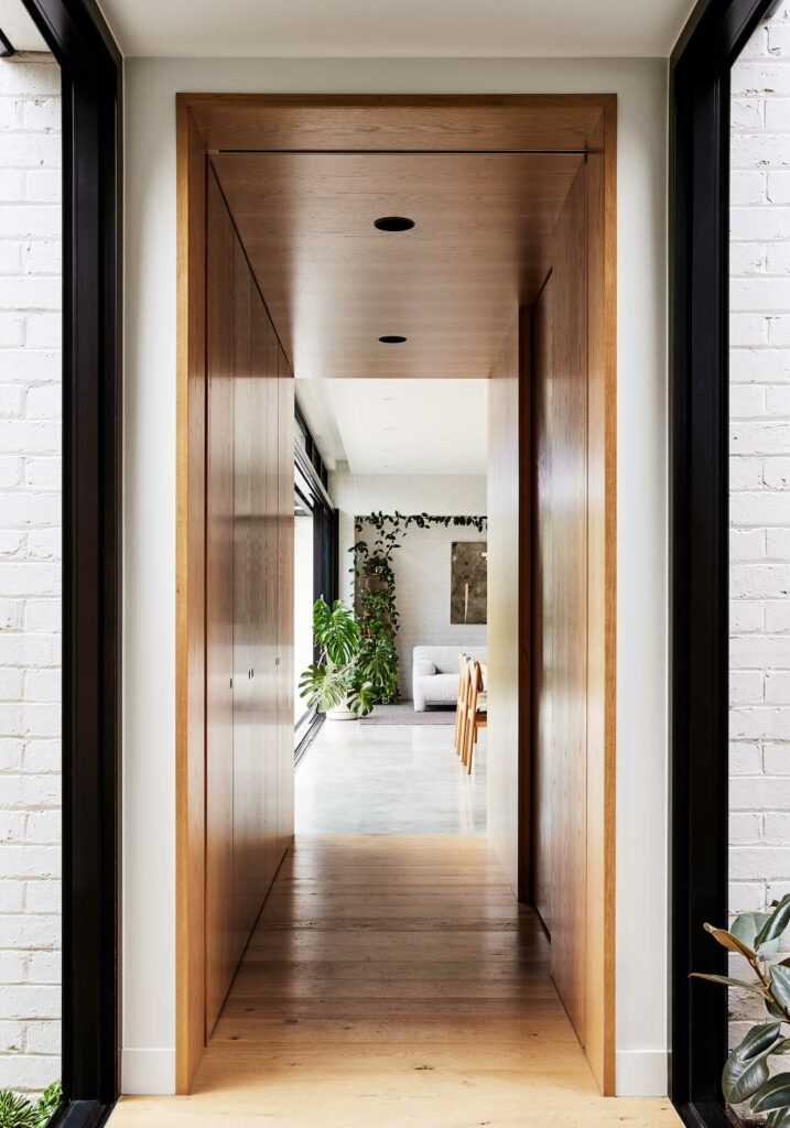 Maike Design garden connection. Glass hallway link. Timber wall panels through to dining room and lounge