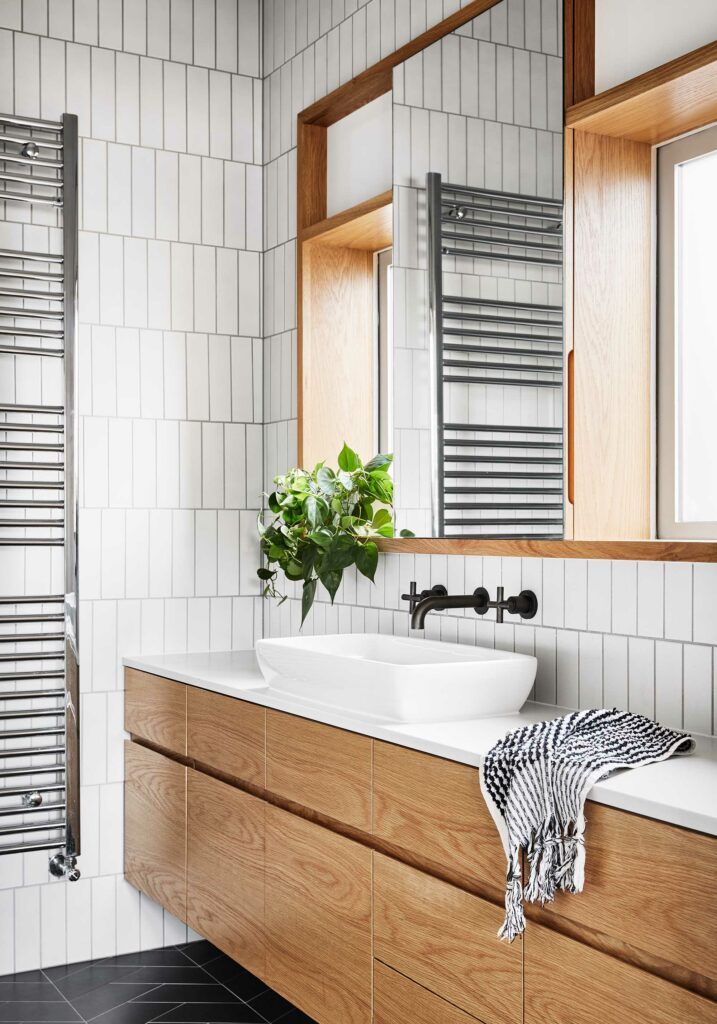 Maike Design bathroom. White and black tiles. Timber joinery and charcoal tapware