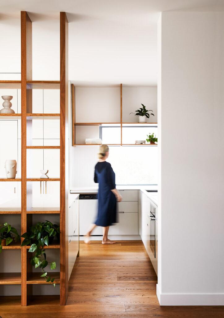 Maike Design kitchen. Open timber shelves, indoor plants, brass tapware, teracotta tiles, timber floors.