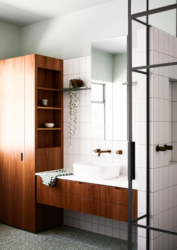 Maike Design bathroom. Timber joinery and brass tapware. Green painted ceiling and terazzo floor tiles. Steel framed shower.