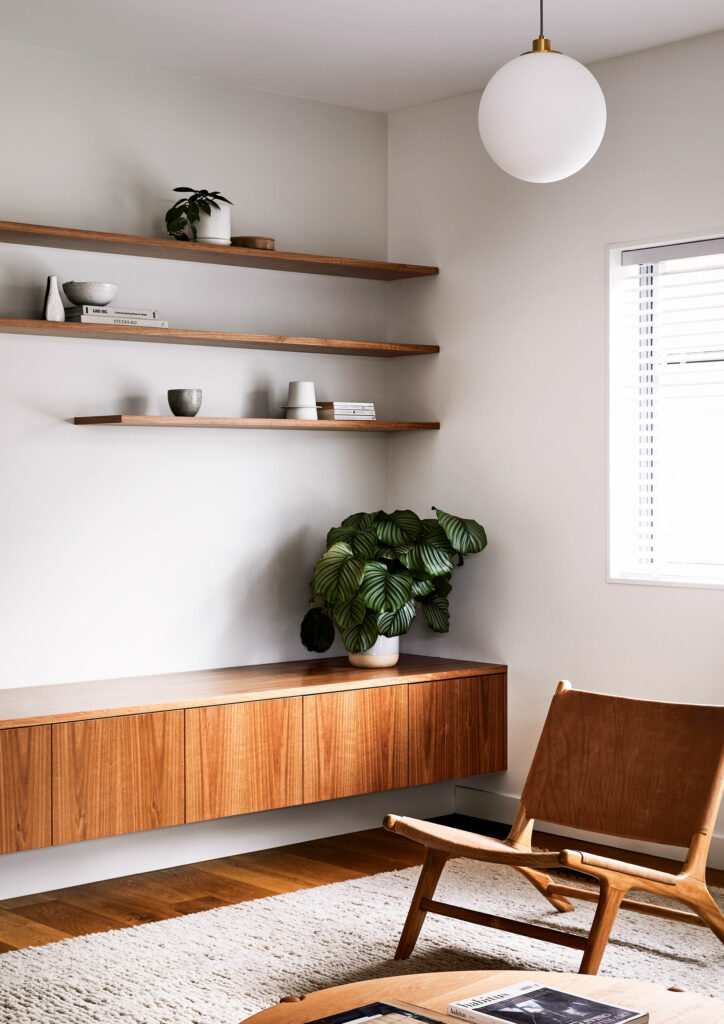 Maike Design lounge room. pendant light, indoor plants and timber joinery. Vintage leather chair