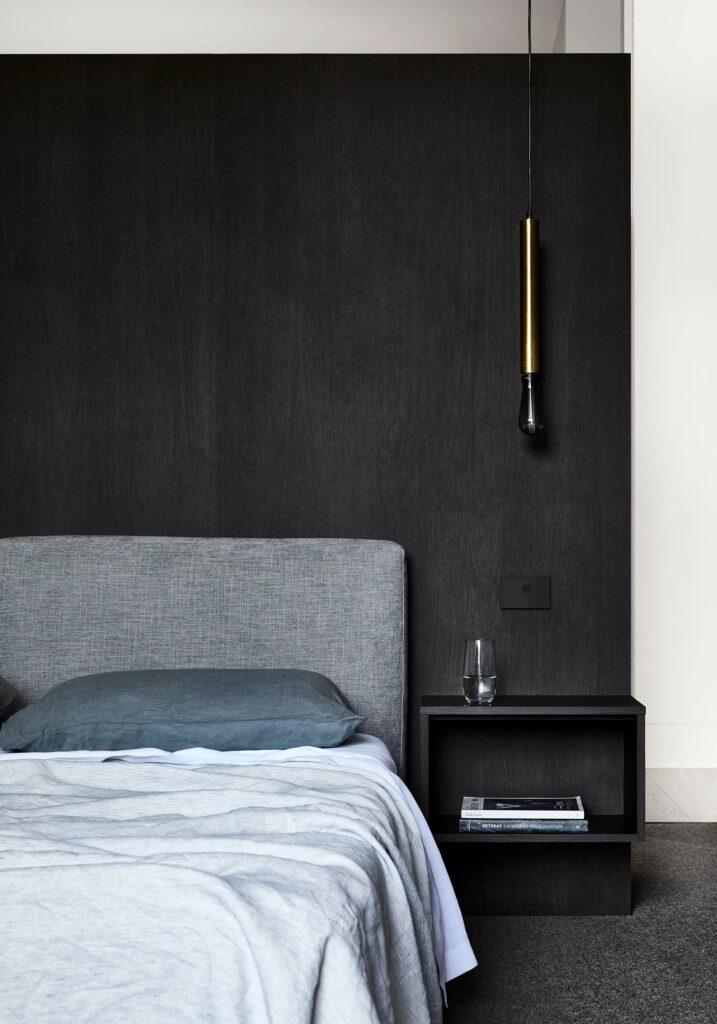 Maike Design bedroom. Dark timber bedhead. Light blue linen.