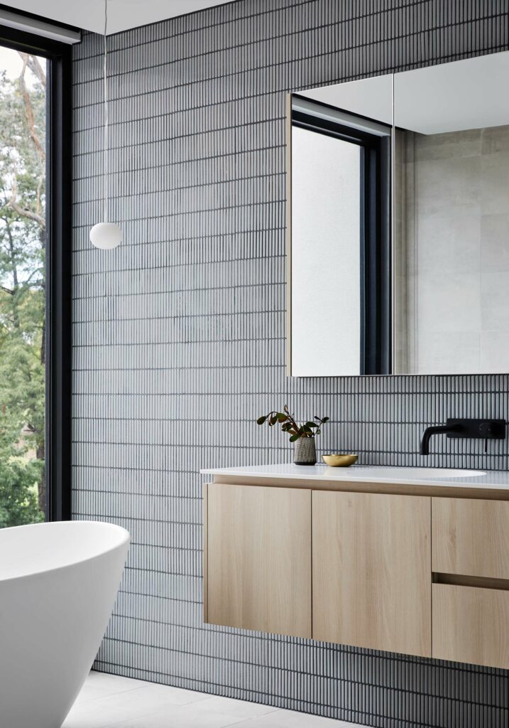 Maike Design bathroom. Mosaic tile, timber vanity and freestanding bath